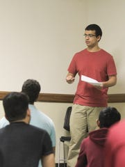 Mohammed Ismail leads a prayer service with the University