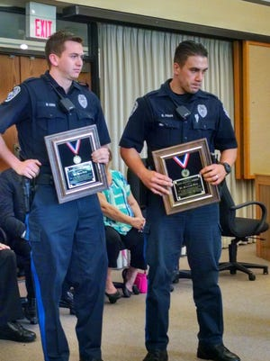 South Brunswick Police Officers Brian Luck and  Salvatore Fama received the Life Saving Medal for saving a man's life in October 2016.