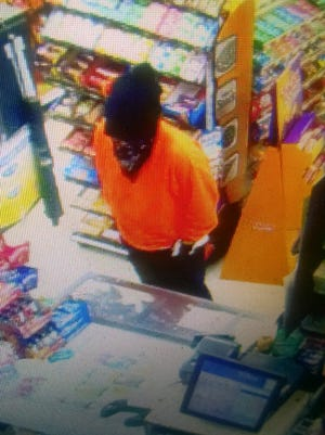Deputies are seeking a man suspected of robbing a Salem Plaid Pantry store at gunpoint Sunday.