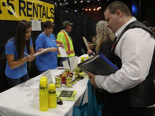 Rush Personnel staffing specialist Maddie Filomeo, left, takes information Thursday from Zach Godsil, right, during the Smart Center Business Resource Center's Job Fair 2017 at the Win River Resort and Casino.