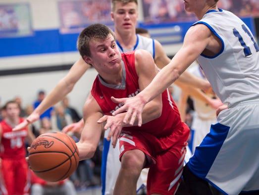 Rockwood's Troy Emert looks to make a pass around Landon