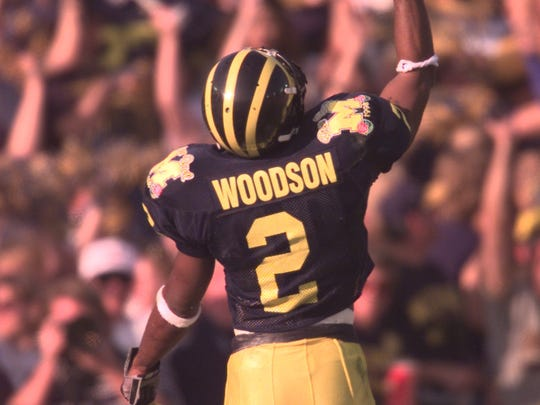 Charles Woodson celebrates his second-quarter interception at the Rose Bowl on Jan. 1, 1998 in Pasadena.