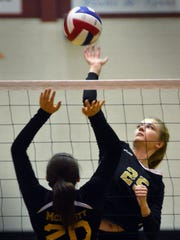 Delone's Olivia Bunch blasts a shot in the first set of Delone's win over Bishop McDevitt Tuesday at Central York.