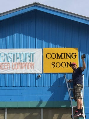"""Josh Parker, owner and head brewer at Eastpoint Beer Company, flashed a big smile recently after hanging a """"Coming Soon"""" sign outside the future site of his new craft brewery. Eastpoint Beer Company hopes to open its doors in August."""