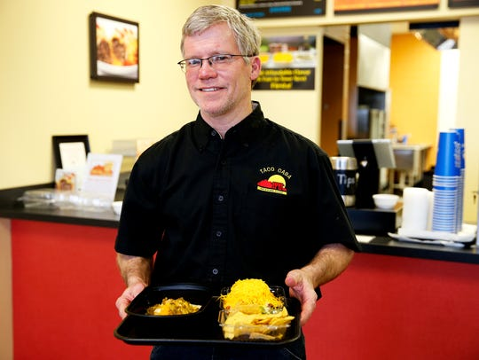 Gene Kennedy, owner of Taco Casa in Norwood is celebrating