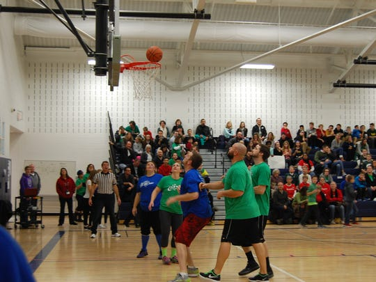 Competing during the Crossover charity game Dec. 16