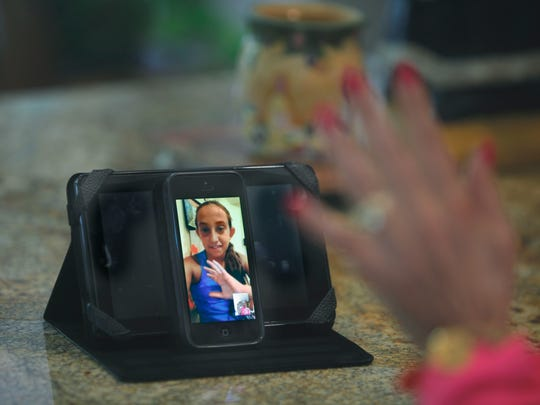 Long Island resident Victoria DiLorenzo,12, uses FaceTime to communicate with her grandmother Valerie Levine, who can see her from her home in Brighton.