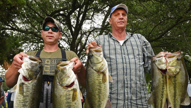 Johnny Johnson (right) and his son Josh Johnson hold the winning stringer of bass that weighed in at 28.29 pounds at The Times All-City Bass Tournament held Saturday at Shreveport's Cross Lake.