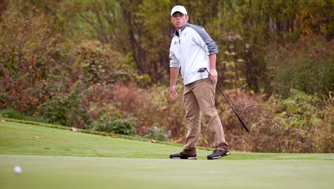 Essex's Brody Yates watches a putt track toward the hole on the ninth green during the Vermont high school boys golf state championships on Wednesday at Green Mountain National Golf Course in Killington.