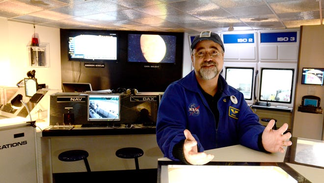 """Paul McFarlane, the lead flight director for the Challenger Learning Center of Northern Nevada, talks about different experiments students can do at the laboratory within the """"space station"""" at the center on Monday, Oct. 6, 2014. The center will open at Sparks High School on Saturday."""