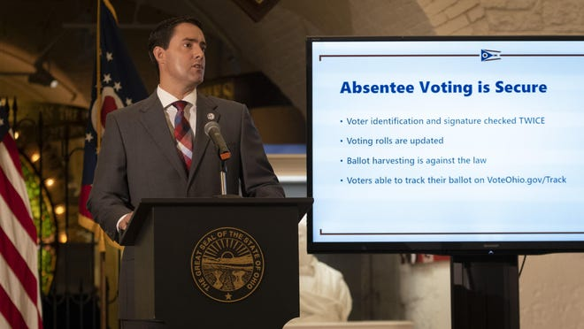 Ohio Secretary of State Frank LaRose delivers an update on absentee voting and election security during a news conference in the Ohio Statehouse Wednesday.