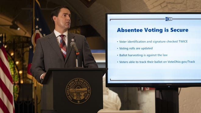 Ohio Secretary of State Frank LaRose delivers an update on absentee voting and election security during a press conference in the Ohio Statehouse in Columbus on Wednesday, Aug. 12, 2020.