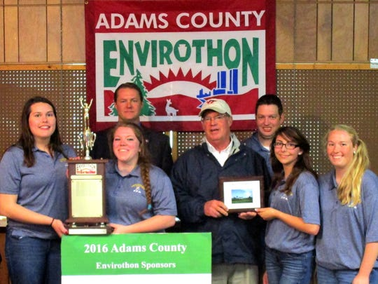 Pictured, from left, are: Cheyenne Schindler, Rebecca Lee, Danielle Reed, Adams Co Commissioners Marty Qually and Randy Phiel, teacher Jesse Brant, Hope Patrick, McKenzie Somers, and Adams County Commissioner Jim Martin.