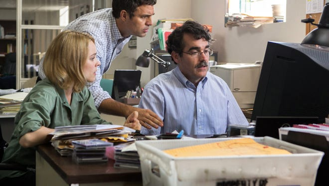 """This photo provided by courtesy of Open Road Films shows, Rachel McAdams, from left, as Sacha Pfeiffer, Mark Ruffalo as Michael Rezendes and Brian d'Arcy James as Matt Carroll, in a scene from the film, """"Spotlight."""" The 73rd annual Golden Globe nominations in film and television categories will be announced Thursday morning, Dec. 10, 2015, in Beverly Hills, Calif.  (Kerry Hayes/Open Road Films via AP)"""