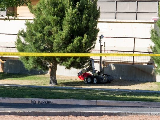 DASO Bomb Squad robot examining the contents of the red bag deemed suspicious at the Pan American Center today.
