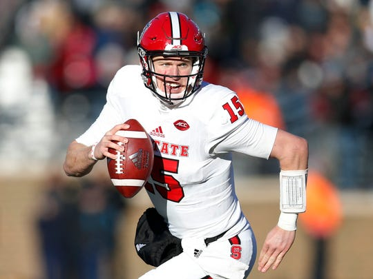 North Carolina State Wolfpack quarterback Ryan Finley (15) gets forced out of the pocket during the second half at Alumni Stadium.