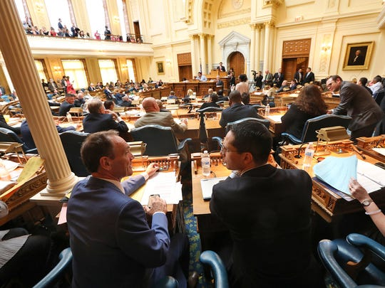 Assemblymen Tim Eustace and Joseph Lagana are shown