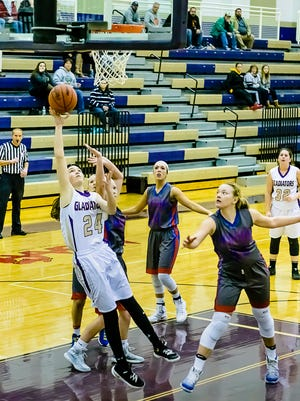 Fowlerville's Elie Smith, 24, ranks among the area leaders in scoring and rebounding.