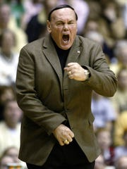 Purdue coach Gene Keady complains about a call as his