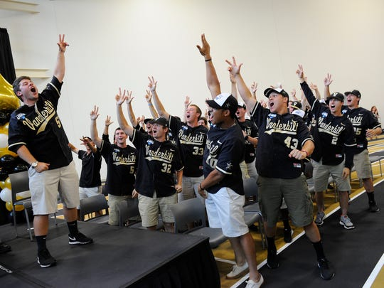 """Vanderbilt pitcher Steven Rice, left, leads his teammates and fans in their """"Anchor Down"""" chant during their NCAA Championship celebration Thursday."""