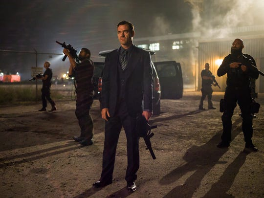 """Marton Csokas, center, appears in a scene from """"The Equalizer."""""""