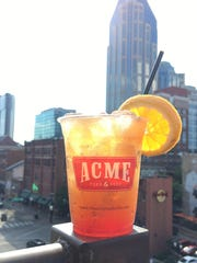 The rooftop bar at Acme Feed & Seed looks out over Broadway on one side, the Cumberland River on the other.