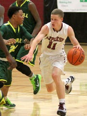 Elmira's Tyler Moffe is defended by Archbishop Carroll's