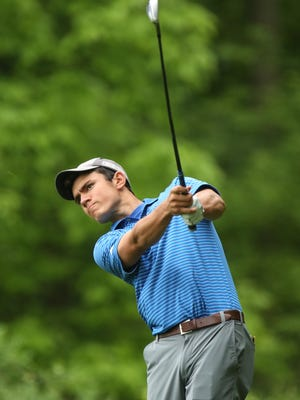 Section 1's Alex Kyriacou tees off on the 8th tee during Round 2 of the NYSPHSAA Boys Golf Championships at Robert Trent Jones Golf Course in Ithaca.