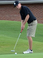 Brentwood's Trevor Johnston watches his putt on the ninth green.