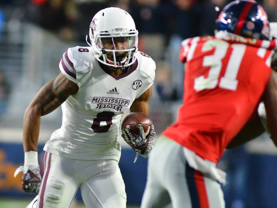 Mississippi State Bulldogs wide receiver Fred Ross (8) carries the ball during the second half of the game against the Mississippi Rebels at Vaught-Hemingway Stadium. Mississippi State won 55-20.