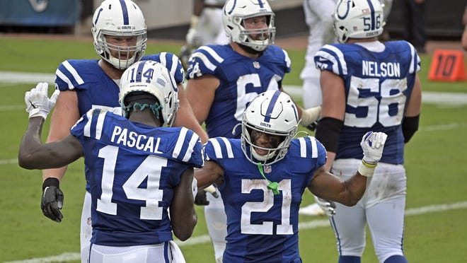 Indianapolis Colts running back Nyheim Hines, center, celebrates a touchdown against the Jacksonville Jaguars with wide receiver Zach Pascal on Sunday. Hines should take on an even bigger role with the Colts now that starting running back Marlon Mack is out for the season.