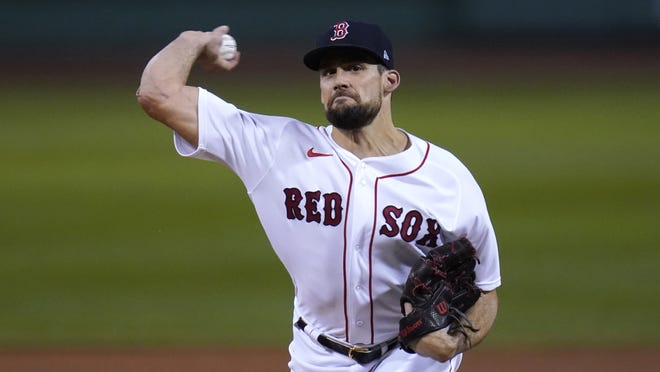 Boston Red Sox starting pitcher Nathan Eovaldi delivers during the first inning of the team'ss baseball game against the Baltimore Orioles in Boston, Wednesday, Sept. 23, 2020, at Fenway Park.