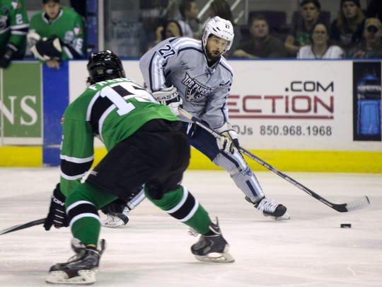 Pensacola Ice Flyers forward Corey Banfield, the top