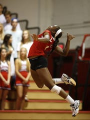 Leon senior Daijah Washington's powerful top serve is just one of many assets a deep Lions team has as it plays in arguably the state's toughest district.