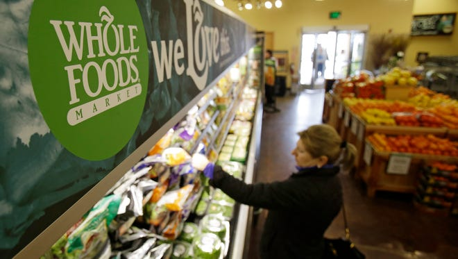 A woman shops at the Whole Foods Market in Woodmere Village, Ohio, in March.