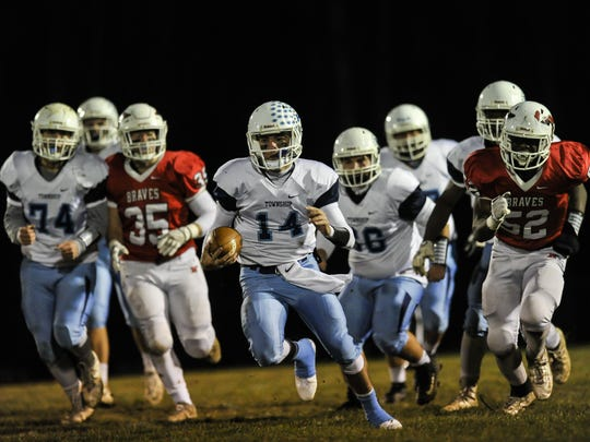 Freehold Township quarterback Nick Reardon scrambles against Manalapan in the NJSIAA Central Group IV semifinal football game in Manalapan on Nov. 17, 2017.