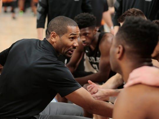 Butler head coach LaVall Jordan talks with his team