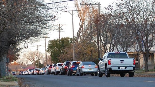 Vehicles are backed up on Poplar Street to south of Crescent Boulevard on Tuesday afternoon as residents line up to be tested for the novel coronavirus inside the state fairgrounds.