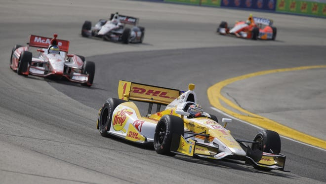 Ryan Hunter-Reay leads a pack of cars through a turn during the Milwaukee IndyFest race at the Milwaukee Mile in West Allis on Saturday. ASSOCIATED PRESS Ryan Hunter-Reay leads a pack of cars through a turn an IndyCar Series auto race at the Milwaukee Mile in West Allis, Wis., Saturday, June 15, 2013. Hunter-Reay won the race. (AP Photo/Jeffrey Phelps)
