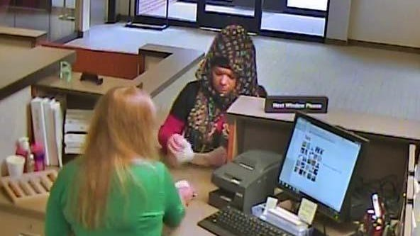 Taylor police are asking for the public's help identifying and locating a woman who allegedly made a bomb threat during the course of a bank robbery Thursday morning.