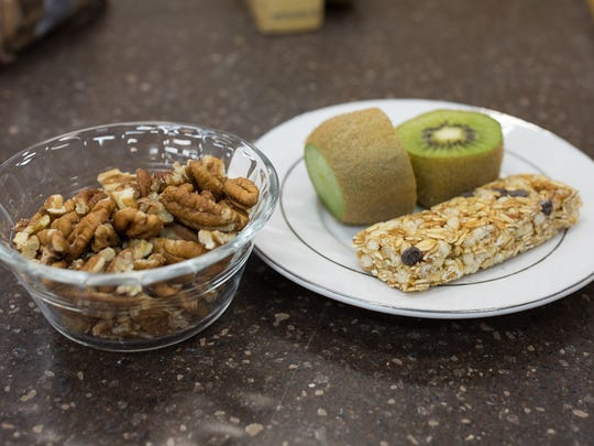 A cereal bar with kiwi and pecans is an example of one of the seven meals the Coastal Bend Food Bank can provide with a $1 donation.