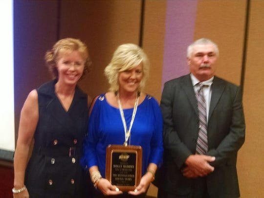 Millersville Assistant City Manager Holly Murphy, middle, was honored with a distinguished service award.