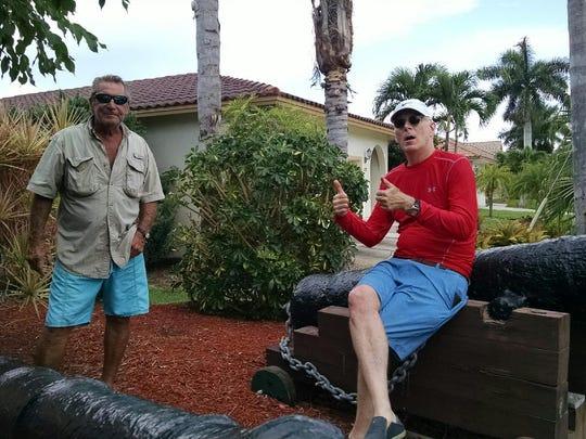 Les Bowen and Bob Asher with Bowen's antique cannon.