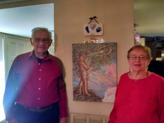 Bob and Bobbie Gray with their Yakov Smirnoff painting,