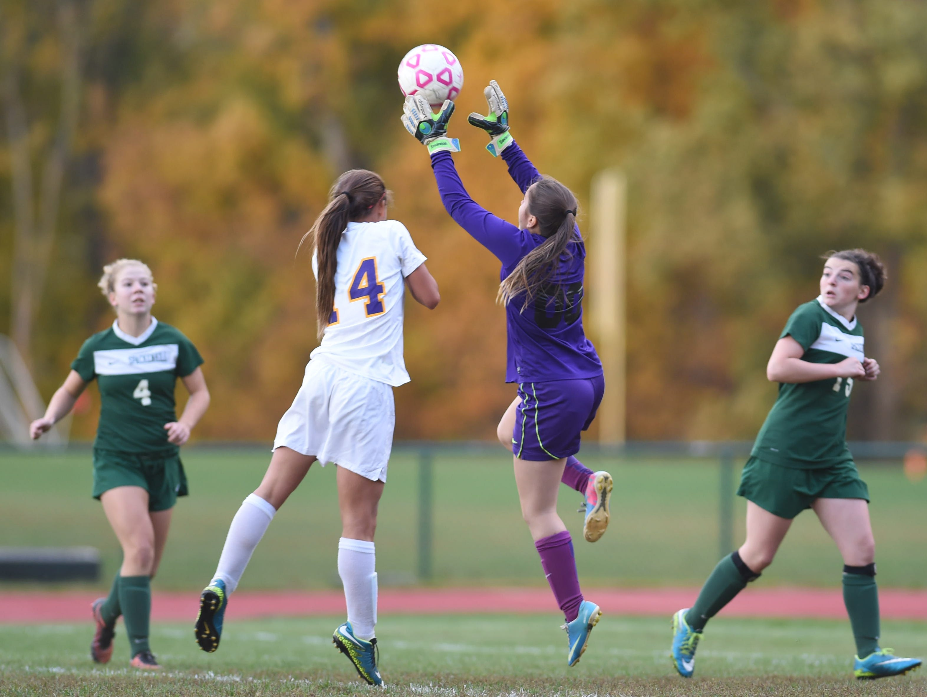 Spackenkill's goalie, Savannah Barefoot grabs the ball away from Rhinebeck's Stephanie Cassens during Wednesday's game in Rhinebeck.