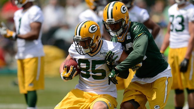 Green Bay Packers tight end Mitchell Henry (85) and safety Morgan Burnett (42) run drills during organized team activities June 2 at Clarke Hinkle Field.