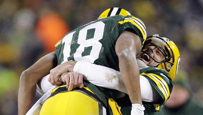 Green Bay Packers quarterback Aaron Rodgers and receiver Randall Cobb celebrate their 42-yard Hail Mary touchdown at the end of the second quarter on Jan. 8, 2016, at Lambeau Field.