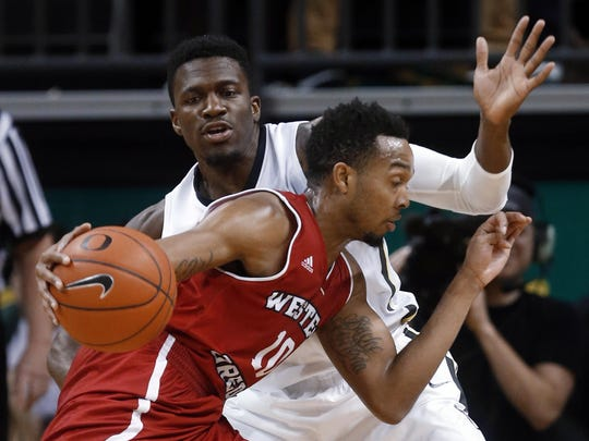 Oregon's Dylan Ennis defends Western Oregon's Julian Nichols during the second half of an NCAA college basketball game Tuesday, Dec. 29, 2015, in Eugene, Ore. Oregon won 88-60.
