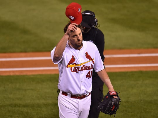 John Lackey tips his hat to the St. Louis crowd after a seven-inning outing against the Cubs in 2015. Lackey spent 15 years in the Major Leagues, winning three World Series championships.