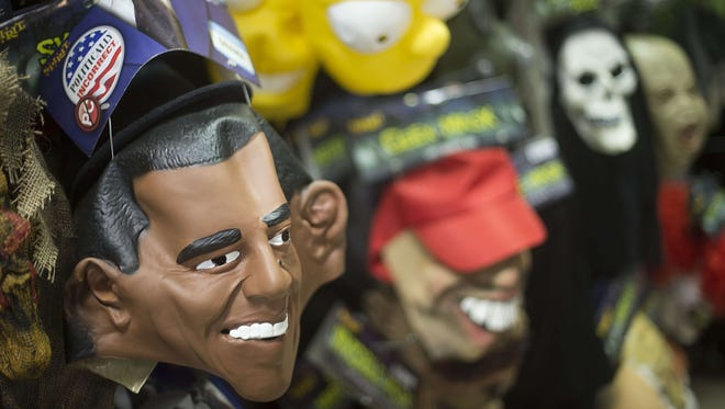 A mask of President Obama sits with other Halloween masks on a wall at Spirit Halloween costume store in Easton, Md., on Oct. 21.